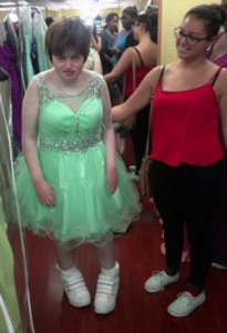 Siobhan and Lauren, Siobhan in a pale green dress with a sparkly waist and sheer netting straps with lots of sparkles.